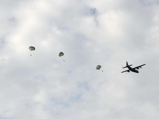 Supply drop ... US airforce transport aircraft this morning delivered by air stocks of food and water for terrified Yazidi sect members hiding in mountains in the north of Iraq. Source: AFP