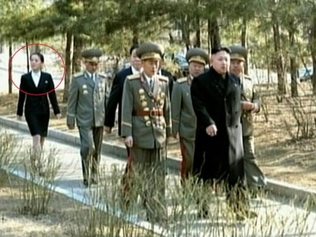 Family matters... Kim Jong-Un, right, flanked by army generals with his sister walking in