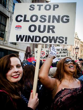 Sex workers and sympathisers demonstrate on April 9, 2015 against the closure of window brothels by the municipality in the red light district in Amsterdam. Picture: Robin van Lonkhuijsen