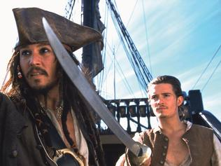 "2003 : Actors Johnny Depp (L) and Orlando Bloom in a scene from 2003 film 'Pirates of the Caribbean: The Curse of the Black Pearl"" Depp/Actor Bloom/Actor"