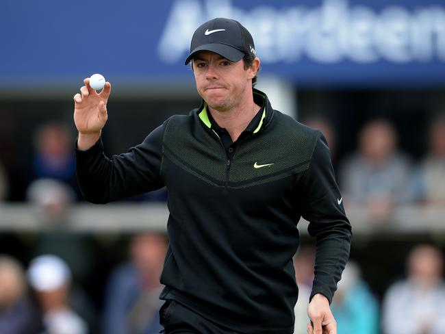 In front ... Rory McIlroy of Northern Ireland Acknowledges the applause from the Gallery around the 18th green during the Aberdeen Asset Management Scottish Open first round.