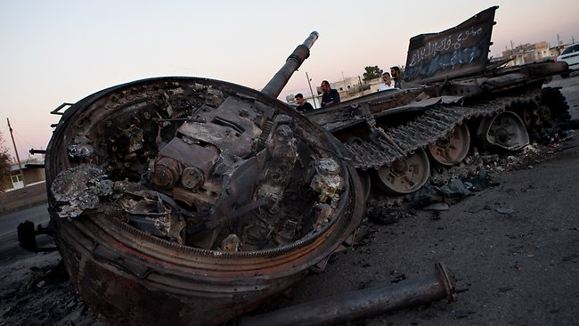 A destroyed Syrian army tank is abandoned after fighting with rebels, on the side of a highway between Aleppo and Damascus (AFP PHOTO/LO)