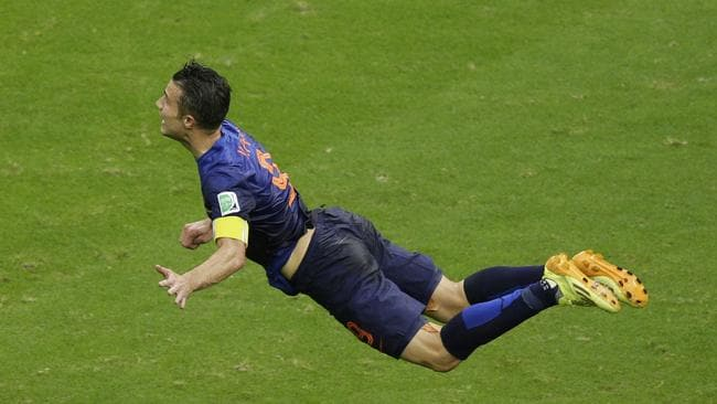 Robin van Persie heads the ball to score during the World Cup match between Spain and the Netherlands.