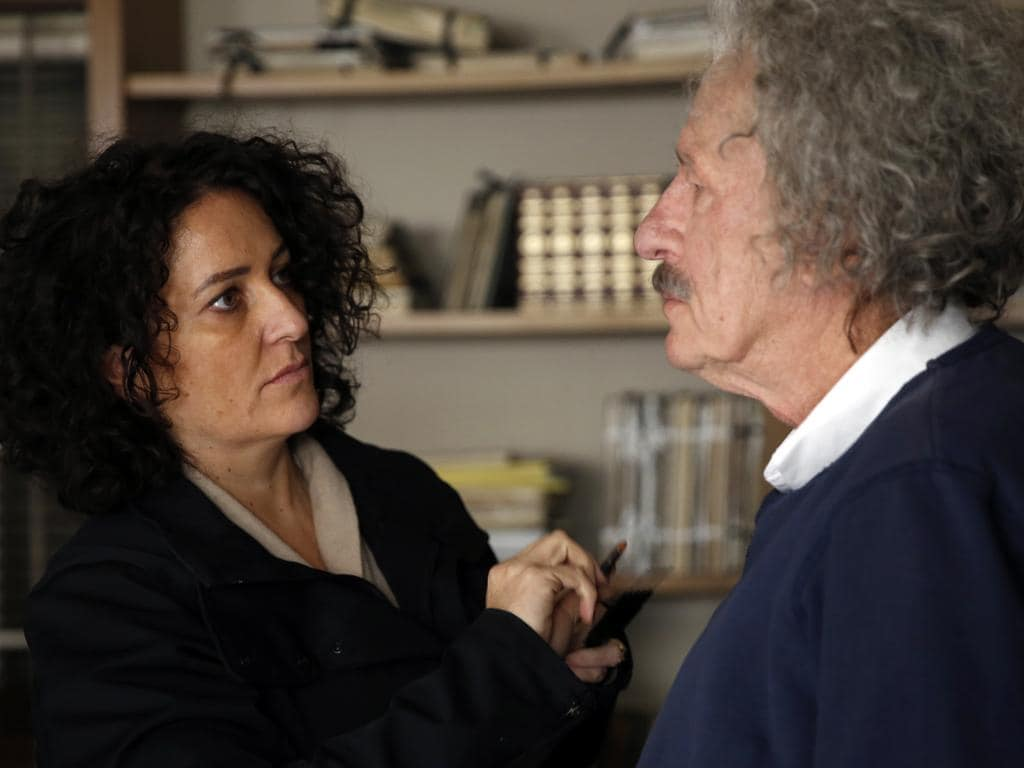 Specialist make-up artist Davina Lamont applies the finishing touches to Geoffrey Rush. Picture: Dusan Martincek/National Geographic