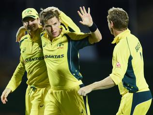 Australian bowler Adam Zampa (C) celebrates with teammates after dismissing South African cricketer Wayne Parnell during their Tri-nation series One Day International match at the Warner Park stadium in Basseterre, Saint Kitts, on June 11, 2016. Australia defeated South Africa by 36 runs. / AFP PHOTO / Jewel SAMAD