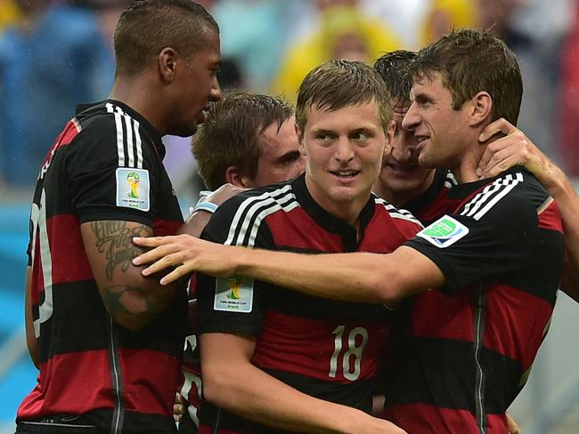 Germany's forward Thomas Mueller (R) celebrates with Jerome Boateng, Philipp Lahm, Toni Kroos and Miroslav Klose.