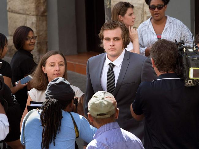 Henri van Breda (centre) is accused of hacking his parents and brother to death. He denies the murders. Picture: AFP/Rodger Bosch