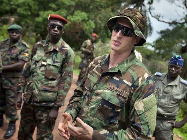 A US Army special forces Captain speaks with troops on the hunt for the LRA. Picture: AP