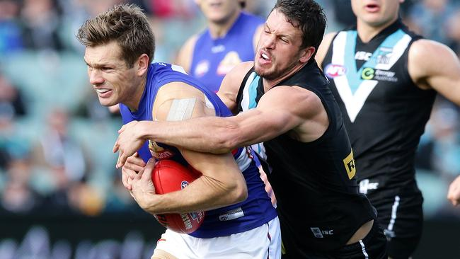 Shaun Higgins can't shake off Travis Boak. Picture: Sarah Reed.