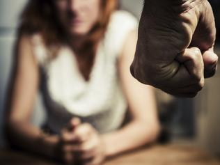 Thinkstock - Woman in fear of domestic abuse.