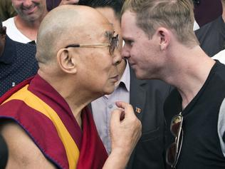 Tibetan spiritual leader the Dalai Lama rubs noses with Australian cricket team captain Steven Smith during an interaction with the team at the Tsuglakhang temple in Dharmsala, India, Friday, March 24, 2017. (AP Photo/Ashwini Bhatia)