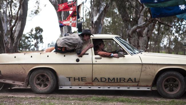 """Jeffery rides in back as Samuel takes the wheel of Spin Out's other star, Billy's ute """"The Admiral"""". Picture: Sony Pictures"""