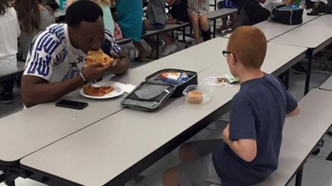 FSU football player eats lunch with boy with autism sitting alone