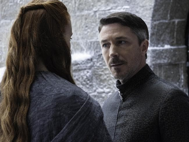 Sansa (Sophie Turner) and Littlefinger (Aidan Gillen) in a scene from season 4 of  <i>Game of Thrones</i>.