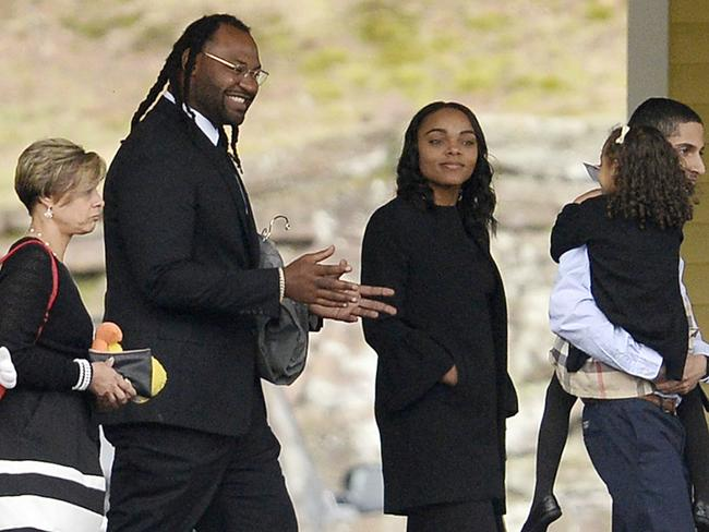 Buffalo Bills linebacker Brandon Spikes, second from left, walks with Aaron Hernandez's fiancee, Shayanna Jenkins Hernandez, second from right, as someone carries her daughter with the NFL star, Avielle. Picture: AP