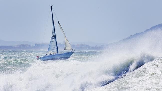 A yacht heads out into rough seas off Mooloolaba. Picture: Lachie Millard