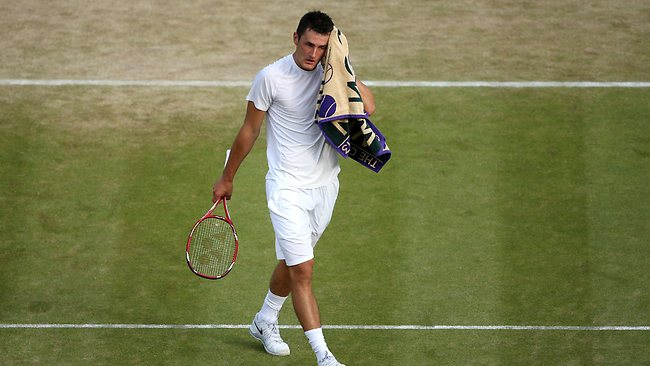 Bernard Tomic during his fourth round match against Tomas Berdych of Czech Republic on day seven of the Wimbledon Lawn Tennis Championships.