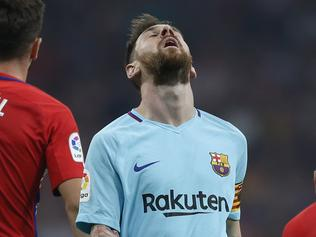 Barcelona's Lionel Messi gestures during a Spanish La Liga soccer match between Atletico Madrid and Barcelona at the Metropolitano stadium in Madrid, Saturday, Oct. 14, 2017. The match ended in a 1-1 draw. (AP Photo/Francisco Seco)