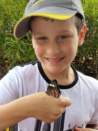 Marcus, now 10, at the Cairns Walk to Remember for Harry.