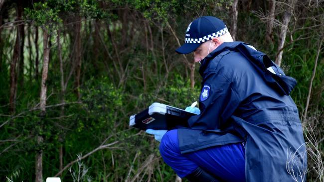 A police officer investigates the death. Picture: Nicole Garmston.