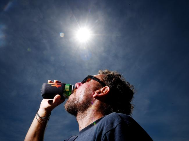 Pete Scott watches the solar eclipse seen from Stokes Hill Wharf in Darwin, Northern Territory. Picture: Elise Derwin
