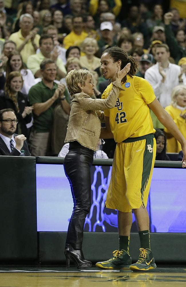 Baylor head coach Kim Mulkey embraces Griner during the NCAA college basketball tournament.