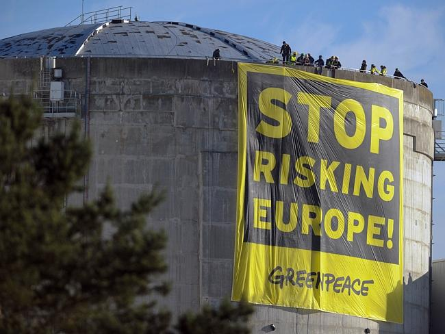 Hard to miss ... Greenpeace atop a reactor at the Fessenheim nuclear plant deploying thei