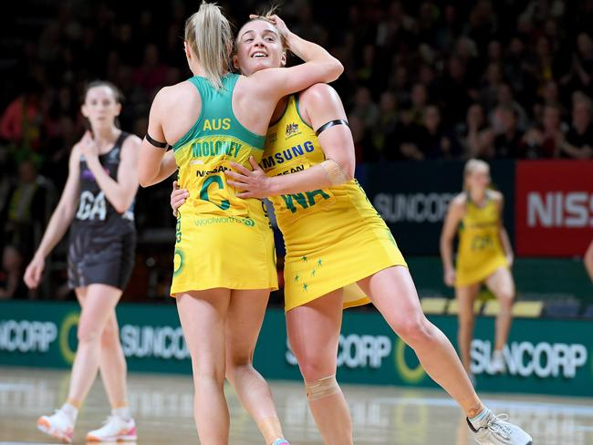 Australia's Kate Maloney and Liz Watson celebrate their win over New Zealand in Adelaide on Wednesday night.