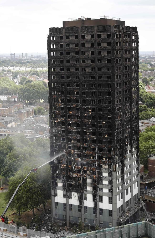 An automated hose sprays water onto Grenfell Tower. Picture: AFP/Tolga Akmen