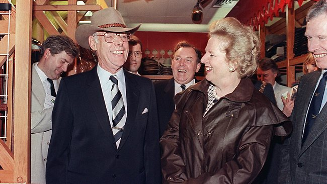 Thatcher, wearing a Drizabone, admires her husband Denis' Akubra in Perth on their August, 1988 visit to Australia. Picture: AFP
