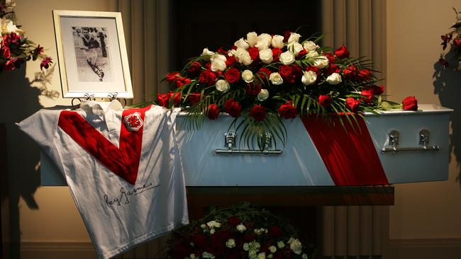 A Saints jumper and photograph sits on top of the coffin of Rugby League Immortal Reg Gasnier at his funeral service.