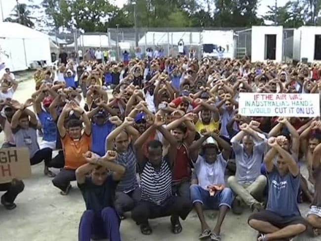 Asylum seekers protesting the possible closure of their detention centre on Manus Island, Papua New Guinea. Picture: Australia Broadcasting Corporation via A, File.