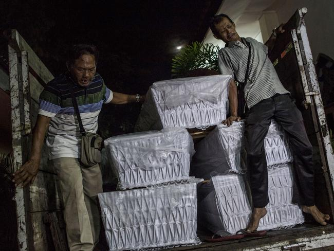 Ominous ... workers load coffins into a truck ahead of the executions of several prisoners, including Bali Nine members Myuran Sukumaran and Andrew Chan. Picture: Ulet Ifansasti/Getty Images