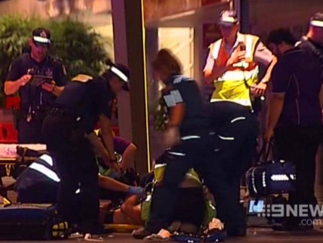 Cole Miller (on the ground) is helped by paramedics after being assaulted. Picture: Channel Nine