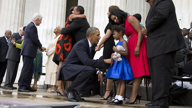 "President Barack Obama talks with Yolanda Renee King, 5, granddaughter of Martin Luther King Jr., her mother Arndrea Waters, and Martin Luther King III, right, after speaking at a ceremony commemorating the 50th anniversary of the March on Washington, Wednesday, Aug. 28, 2013, at the Lincoln Memorial in Washington. The president was set to lead civil rights pioneers Wednesday in a ceremony for the 50th anniversary of the March on Washington, where Dr. Martin Luther King's ""I Have a Dream"" speech roused the 250,000 people who rallied there decades ago for racial equality. From left are, Rep. John Lewis, D-Ga., former President Jimmy Carter and former President Bill Clinton. (AP Photo/Evan Vucci)"
