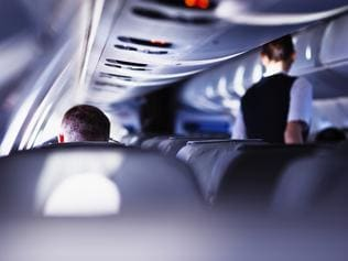 Airplane cabin during flight. Shallow DOF, selective focus.