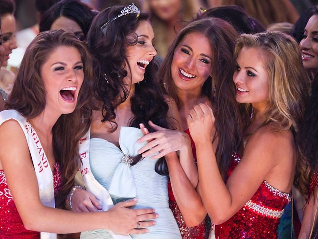 Miss World 2nd runner-up winner Miss Wales Sophie Moulds, second left, is congratulated by other contestants. Picture: AP