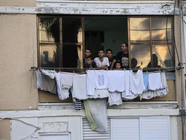 Truce rejected. Israelis look at the site where a rocket fired by Palestinian militants hit in the southern Israeli city of Ashkelon. Picture: AP