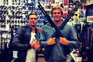 Swimmers Nick D'Arcy and Kenrick Monk pose with guns in US gun shop. Picture: Facebook