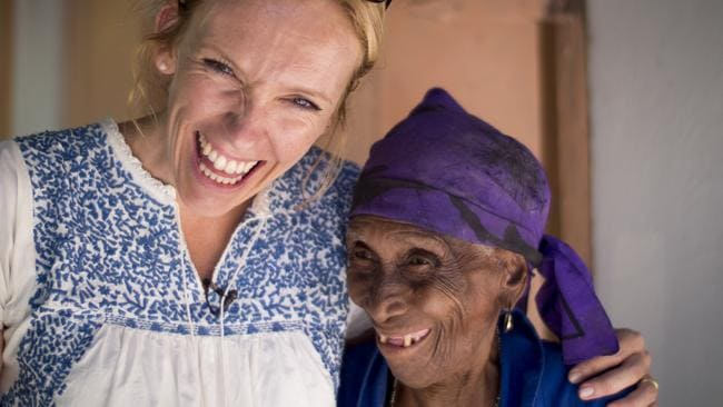 Toni Collette, Concern Worldwide's global ambassador, with Carmen Pierre, during a visit to Saut d'Eau in Haiti.
