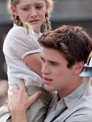 social criticism in the hunger games The hunger games: catching fire and was surprised at how both soft-pedal the dystopic elements and play down the social criticism and political implications.