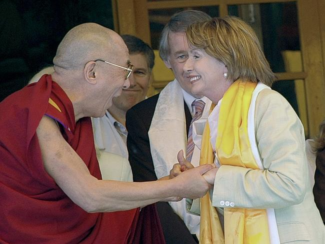 An emotional touch ... Tibetan spiritual leader the Dalai Lama reacts after meeting US House Speaker Nancy Pelosi in Dharmsala, India back in 2008. Picture: AP