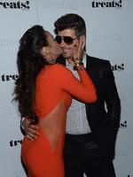 "Robin Thicke claimed that the idea to release the naughty version of the video was actually his wife's idea. The pair attend the ""Blurred Lines"" Record Release Party at No. 8 on September 4, 2013 in New York City. Picture: Getty"