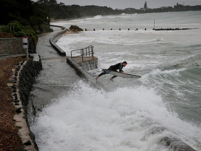 A surfer braves the rough conditions at Point Lonsdale. Picture: Colleen Petch