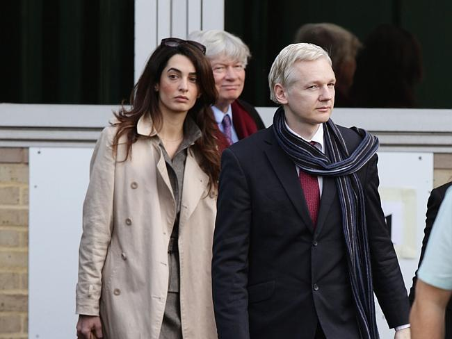 Amal Alamuddin, left, is seen walking alongside WikiLeaks founder Julian Assange as they