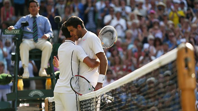 Novak Djokovic of Serbia comforts Juan Martin Del Potro of Argentina after he lost their epic semi final match.