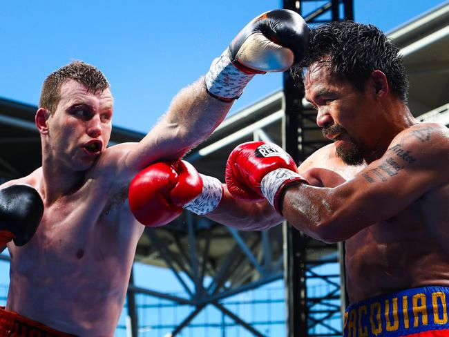 Manny Pacquiao of the Philippines (R) fighting Jeff Horn of Australia.