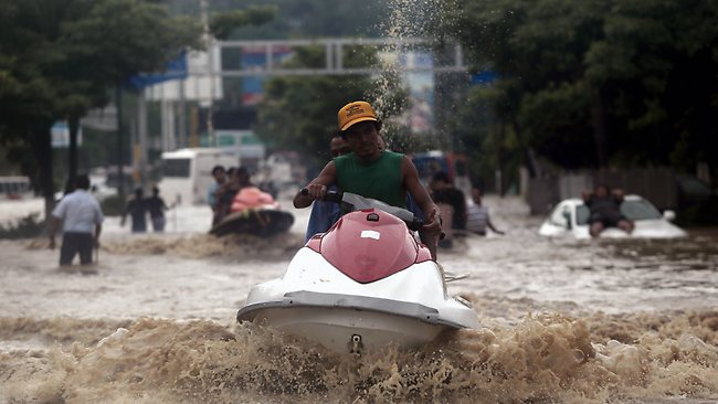 TOPSHOTSA man carries residents on a jet ski in Acapulco, Guerrero state, Mexico, after heavy rains hit the area on September 16, 2013. Hurricane Ingrid weakened to tropical storm strength as it made landfall on the northeastern coast in the morning while the Pacific coast was reeling from the remnants of Tropical Storm Manuel, which dissipated after striking on the eve. Thousands of people were evacuated on both sides of the country as the two storms set off landslides and floods that damaged bridges, roads and homes. AFP PHOTO AFP PHOTO / Pedro Pardo