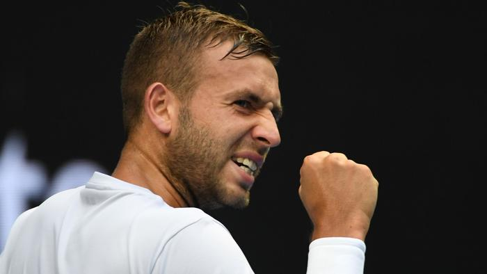 Britain's Daniel Evans reacts on a point against Australia's Bernard Tomic during their men's singles third round match on day five of the Australian Open tennis tournament in Melbourne on January 20, 2017. / AFP PHOTO / SAEED KHAN / IMAGE RESTRICTED TO EDITORIAL USE - STRICTLY NO COMMERCIAL USE