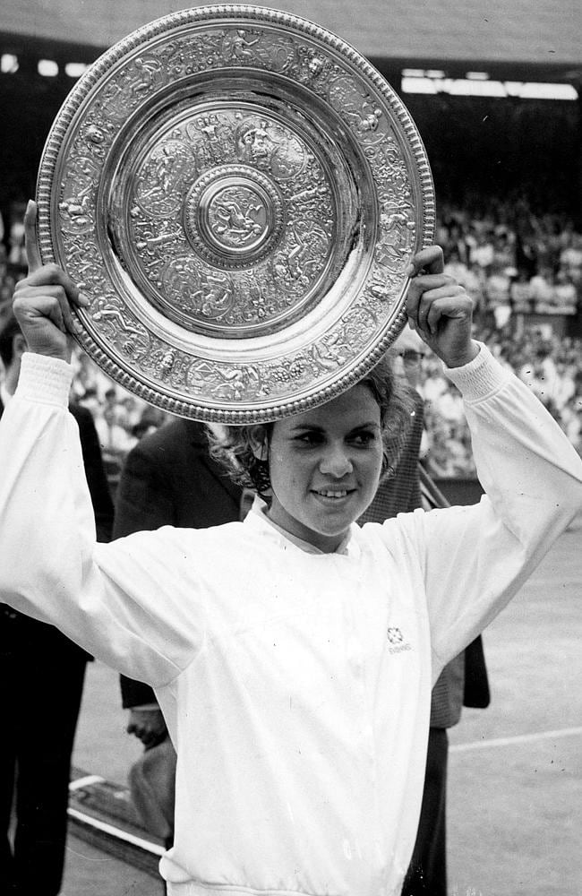 Evonne Goolagong Cawley with the Wimbledon trophy she won in 1971